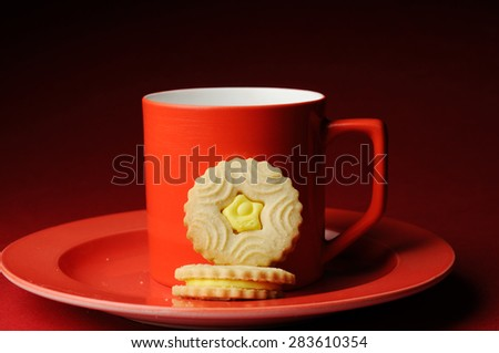 cream biscuits with coffee mug - stock photo