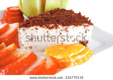 cream cake and raw fruits on plate - stock photo