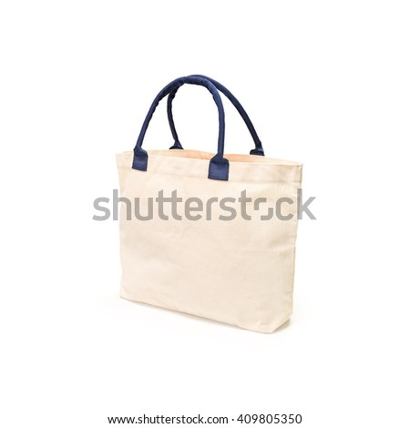 Cream canvas hand bag on white background. Blank fashion shopping sackcloth for your design.