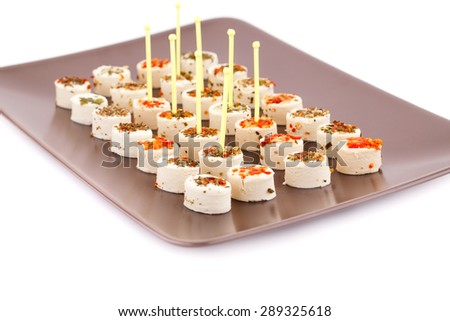 Cream cheese on brown plate on white background. - stock photo