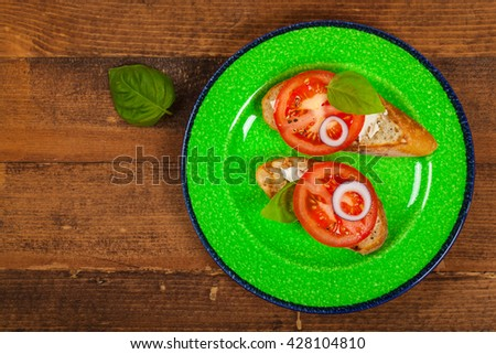 Cream Cheese Tomato and Basil Sandwich. Selective focus. - stock photo