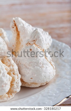 cream-colored meringue on a plate close-up. soft focus