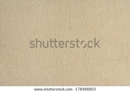 Cream coloured canvas texture paper background
