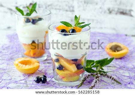 Cream dessert with fruit and berries - stock photo