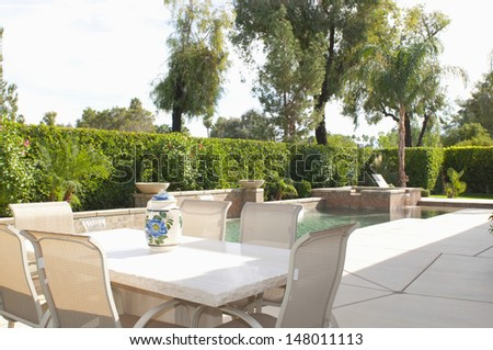 Cream dining furniture at poolside