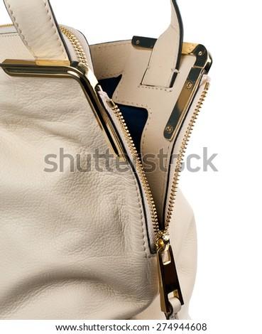 Cream handbag isolated on white background. - stock photo