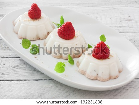 Cream jelly dessert with strawberries - stock photo