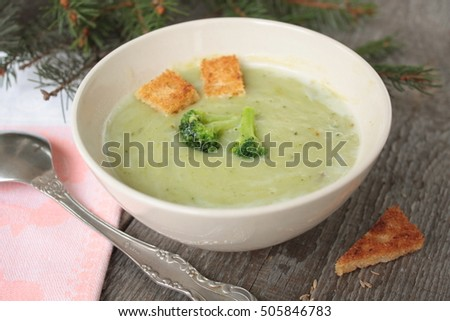 cream of broccoli soup with croutons and flax seed. hot autumn vegetable soup.