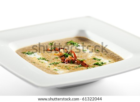 Cream of Mushroom Soup with Fried Mushrooms and Green Herb - stock photo