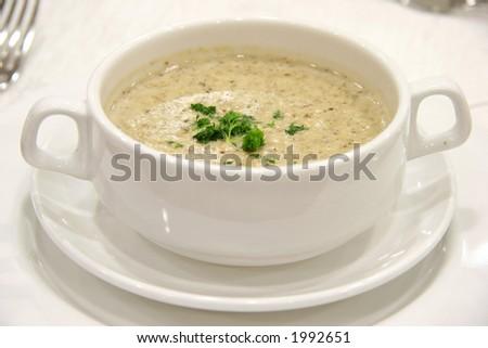Cream of mushroom veloute served in a plain ceramic bowl - stock photo