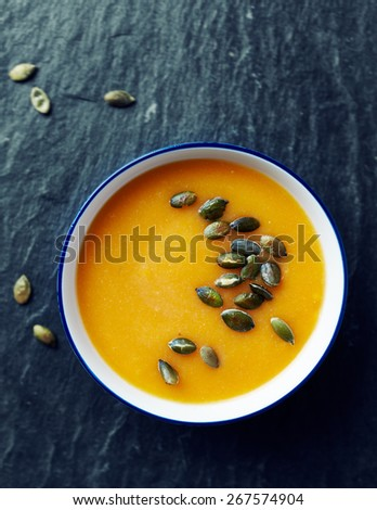 Cream of pumpkin soup with pumpkin seeds  - stock photo