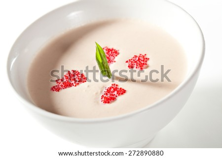 Cream of Salmon Soup with Greens and Red Flying Fish Roe - stock photo