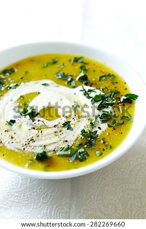 Cream of vegetable soup with sour cream and parsley - stock photo