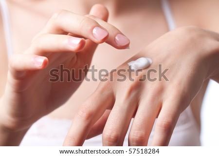 Cream on the women hand. - stock photo