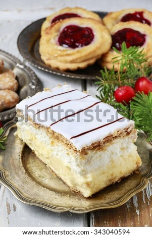Cream pie made of two layers of puff pastry, filled with whipped cream. - stock photo