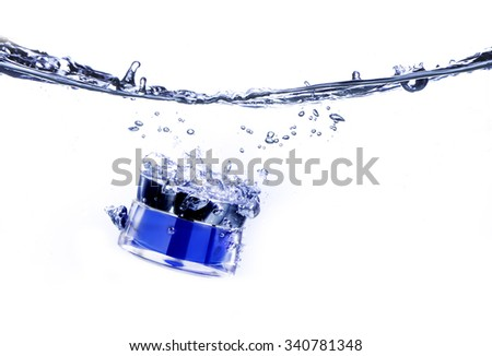 Cream pot drop and water splash. Concept beauty and felling fresh - stock photo