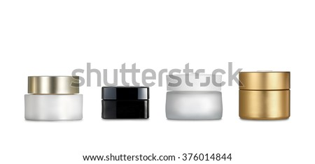 Cream pots. Four cosmetics containers isolated on white background. Clipping path - stock photo