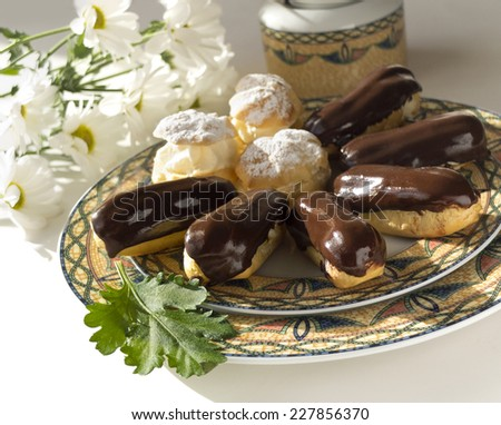 Cream puff and eclair cakes with chamomile