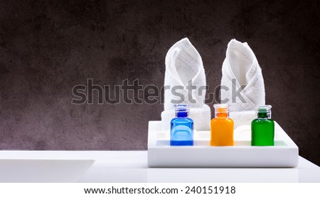 Cream, shampoo and shower in the bathroom - stock photo