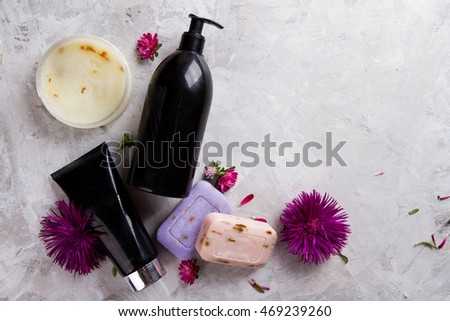 Cream, soap bar and liquid shower gel for aromatherapy, selective focus, top view