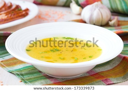 Cream soup of red lentil with smoked meat, duck, chicken, garlic, dietary oriental dish with spices