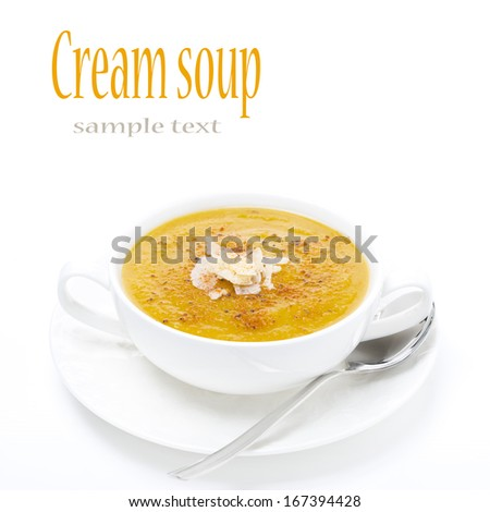 cream soup of yellow lentils in a white bowl, isolated on white - stock photo