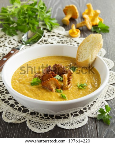 Cream soup with chanterelle mushrooms and pumpkin. - stock photo