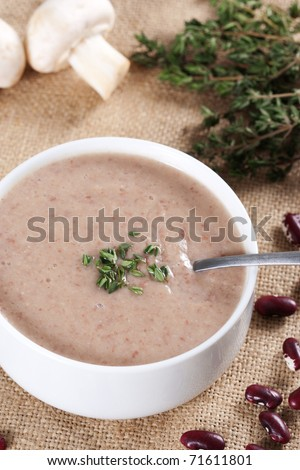 Cream soup with mushrooms and bean - stock photo