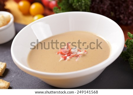 Cream soup with seafood - stock photo