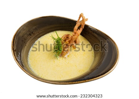 Cream soup with seafood. Isolated on white background.