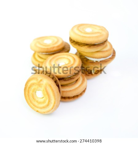 Cream stuffed cookies isolated. - stock photo