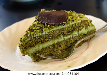 Cream with Pistachios, Cassata or Cassata siciliana is a traditional sweet from the areas of Palermo, Catania and Messina,Sicily, Italy - stock photo