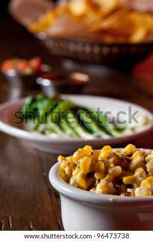 Creamed corn with grilled scallions - stock photo