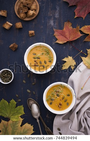 Creamed pumpkin soup with croutons and seeds