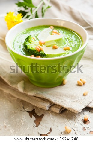 creamy broccoli soup with cheese and pine nut - stock photo