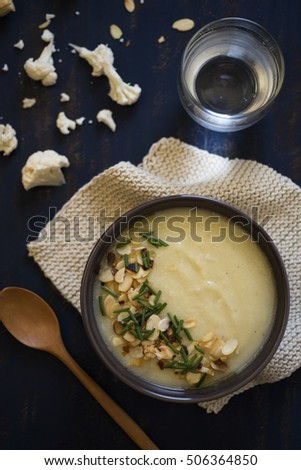 Creamy Cauliflower Soup with a cup of water