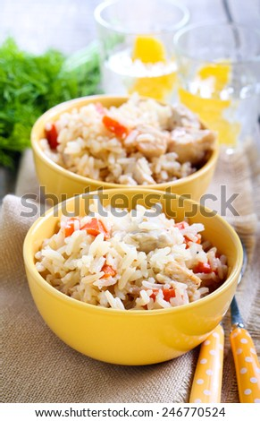 Creamy chicken and carrot rice in bowls