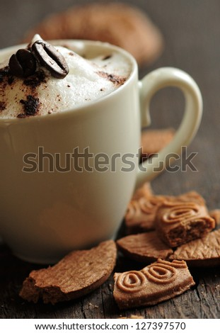 Creamy coffee with cookies