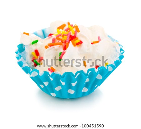 Creamy cupcake isolated on white