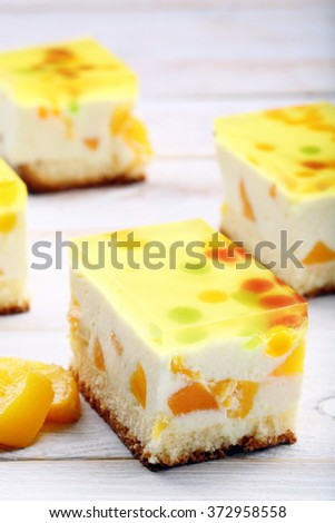 Creamy fruit cake with yellow jelly. Catering set.