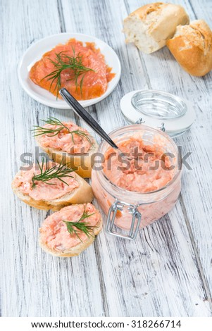 Creamy homemade Salmon Salad (with fresh dill) on wooden background - stock photo