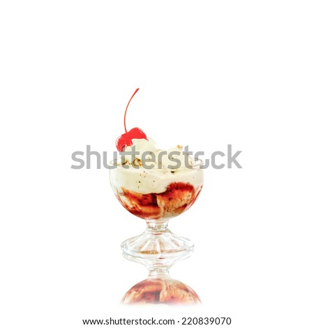 creamy ice cream with cherries on plate in glass bowl, on white background