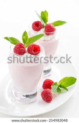creamy jelly with raspberries and mint - stock photo