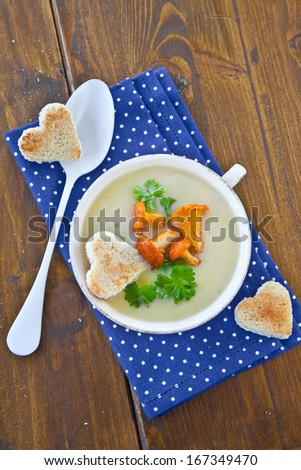 Creamy mushroom soup with fresh chanterelles and toast - stock photo