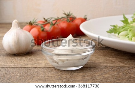 Creamy onion dressing salad - stock photo