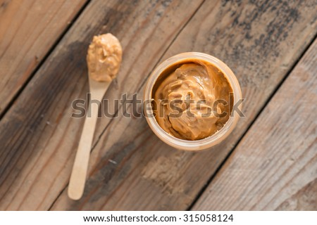 Creamy Peanut Butter in jar. Top view. - stock photo