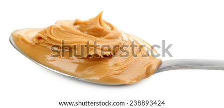 Creamy peanut butter in spoon, isolated on white - stock photo