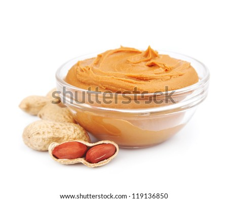 Creamy peanut butter with nuts isolated on white - stock photo