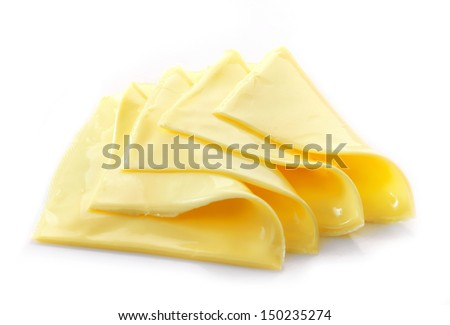 Creamy processed cheese slices on white background