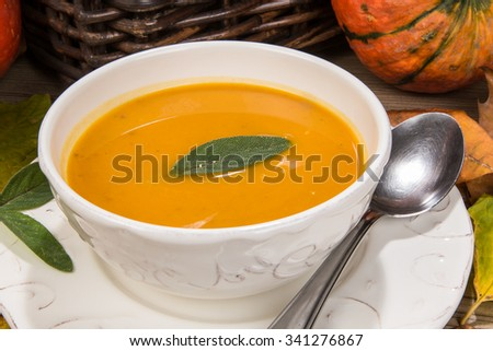 Creamy pumpkin soup is typical for autumn season